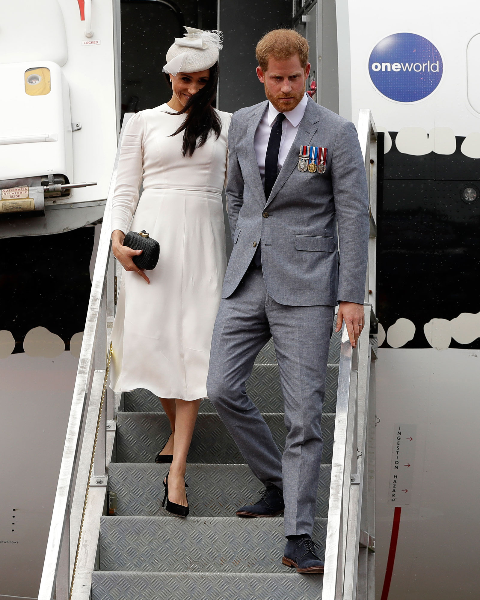 "<div class=""meta image-caption""><div class=""origin-logo origin-image none""><span>none</span></div><span class=""caption-text"">Britain's Prince Harry and Meghan, Duchess of Sussex disembark from their plane on their arrival in Suva, Fiji, Tuesday, Oct. 23, 2018. (Kirsty Wigglesworth, Pool/AP Photo)</span></div>"