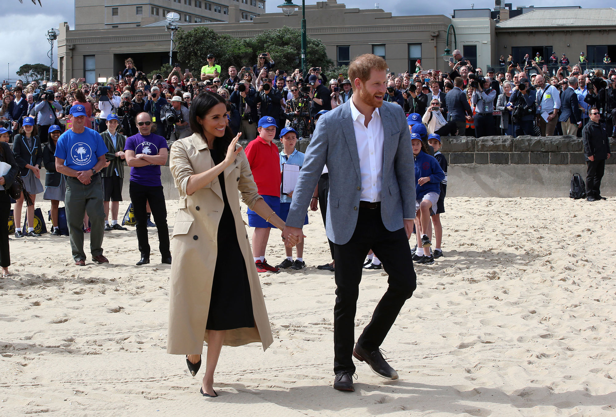 "<div class=""meta image-caption""><div class=""origin-logo origin-image none""><span>none</span></div><span class=""caption-text"">Prince Harry and Meghan, Duchess of Sussex walk across the sand at South Melbourne Beach in Melbourne, Australia, Thursday, Oct. 18. (Ian Vogler/Pool Photo via AP)</span></div>"