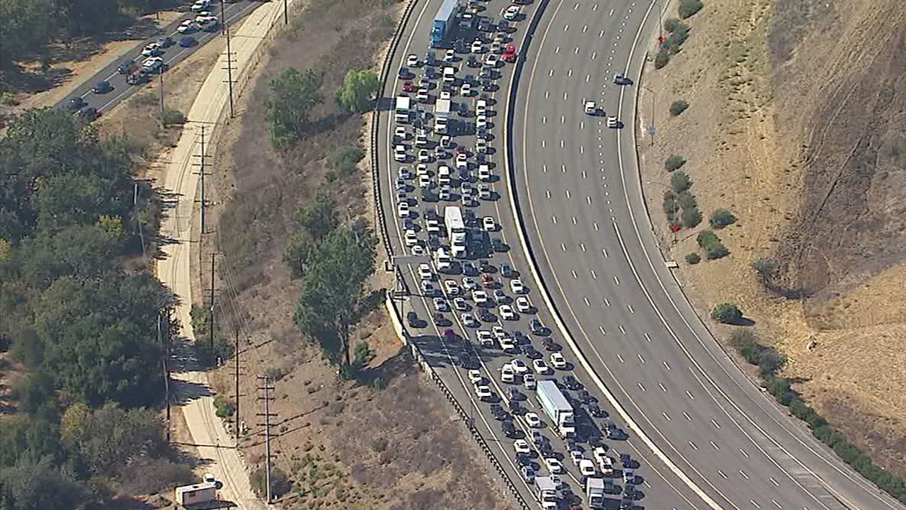 <div class='meta'><div class='origin-logo' data-origin='KABC'></div><span class='caption-text' data-credit=''>Traffic is backed up for miles after a small plane crashed on the westbound 101 in Agoura Hills on Tuesday, Oct. 23, 2018.</span></div>