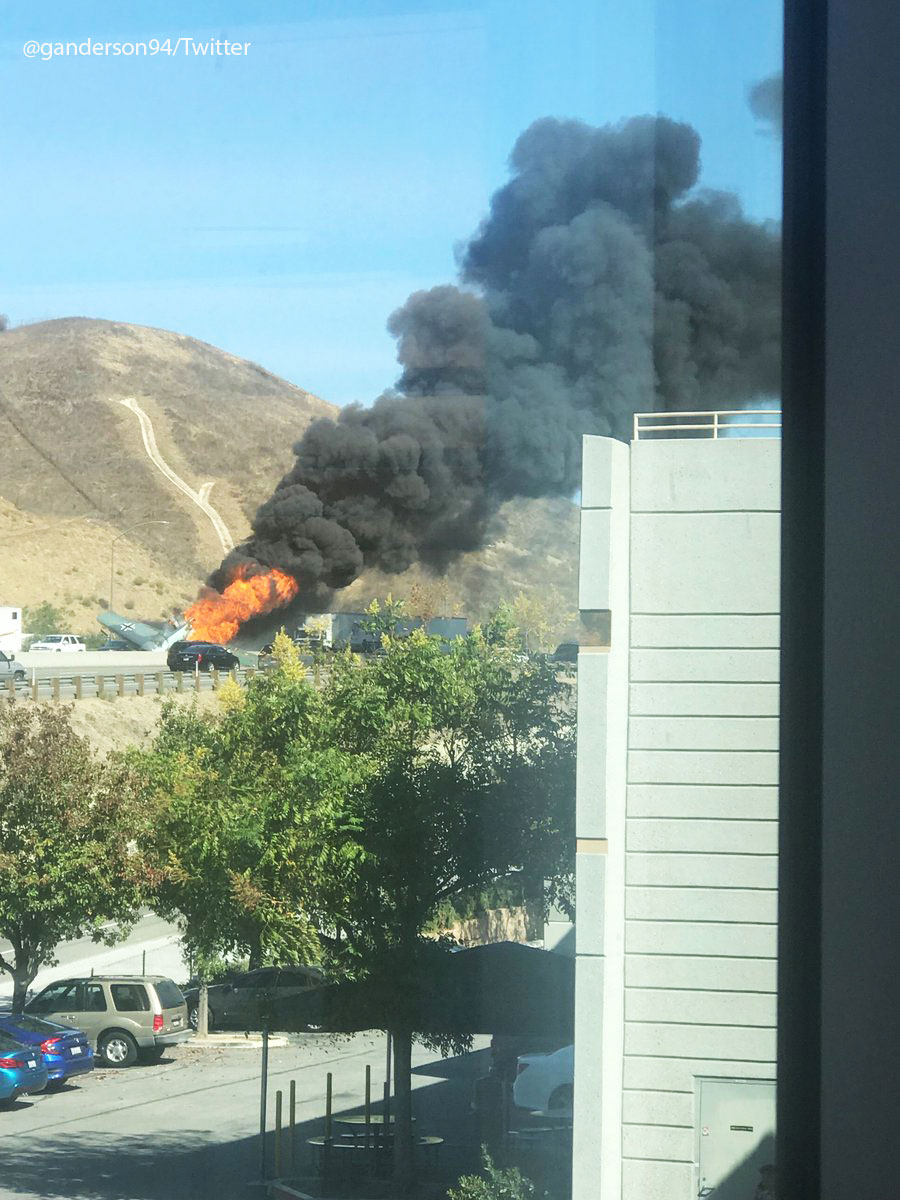 <div class='meta'><div class='origin-logo' data-origin='KABC'></div><span class='caption-text' data-credit=''>Flames and smoke shoot out of a small plane that crashed on the 101 Freeway in Agoura Hills on Tuesday, Oct. 23, 2018.</span></div>
