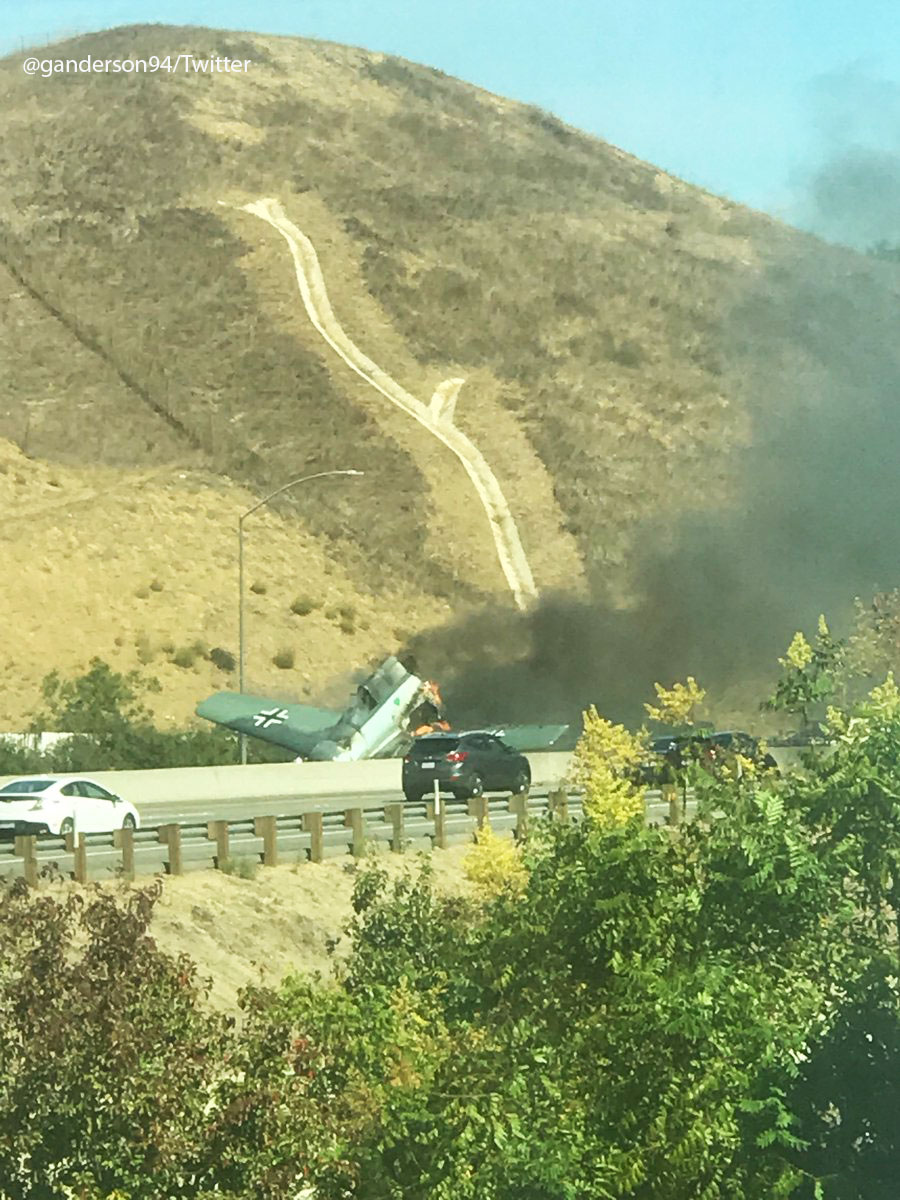 <div class='meta'><div class='origin-logo' data-origin='KABC'></div><span class='caption-text' data-credit=''>Smoke shoots out of a small plane that crashed on the 101 Freeway in Agoura Hills on Tuesday, Oct. 23, 2018.</span></div>