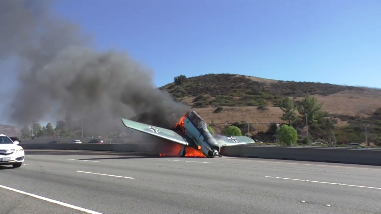 <div class='meta'><div class='origin-logo' data-origin='none'></div><span class='caption-text' data-credit='KABC'>A World War II-era small aircraft is shown on fire after the pilot crashed it into the westbound lanes of the 101 Freeway in Agoura Hills.</span></div>