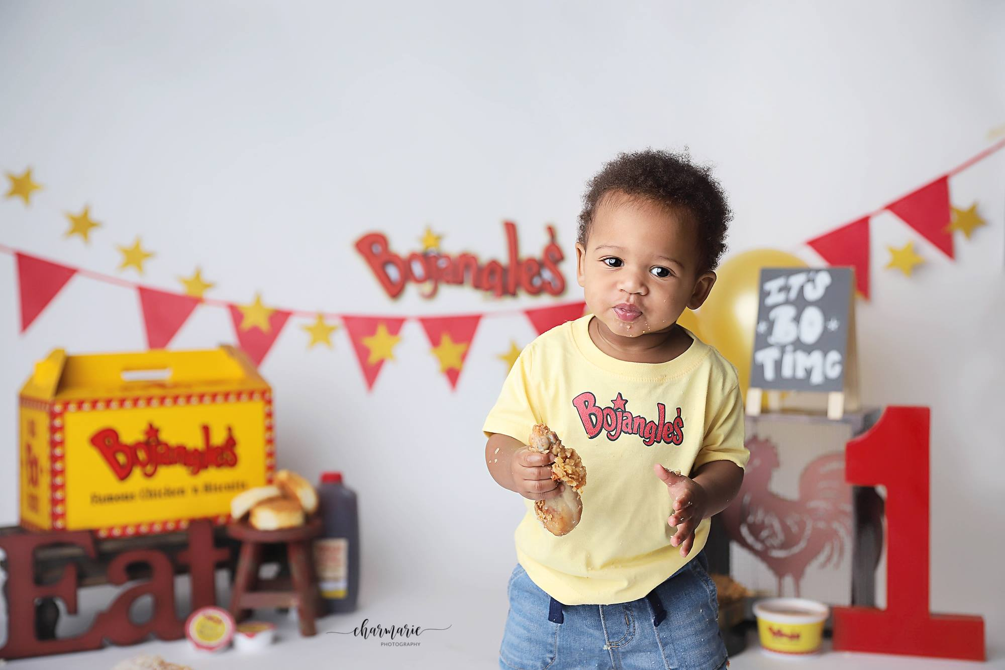 <div class='meta'><div class='origin-logo' data-origin='none'></div><span class='caption-text' data-credit='Courtesy of CharMarie Photography'>Luke Hansen's mom craved Bojangles while she was pregnant so it was only appropriate when that first birthday came around, he would get a Bojangles themed photo shoot.</span></div>