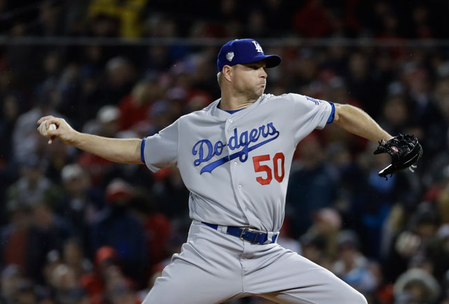 <div class='meta'><div class='origin-logo' data-origin='AP'></div><span class='caption-text' data-credit='AP Photo/Matt Slocum'>Los Angeles Dodgers' Ryan Madson throws during the fifth inning of Game 1 of the World Series baseball game against the Boston Red Sox Tuesday, Oct. 23, 2018, in Boston.</span></div>