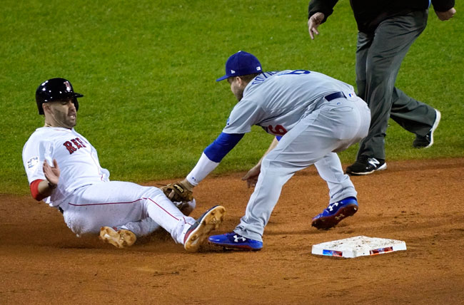 <div class='meta'><div class='origin-logo' data-origin='AP'></div><span class='caption-text' data-credit='AP Photo/Elise Amendola'>Los Angeles Dodgers second baseman Brian Dozier tags out Boston Red Sox's J.D. Martinez, left, as he tried to steal second base during Game 1 of the World Series.</span></div>