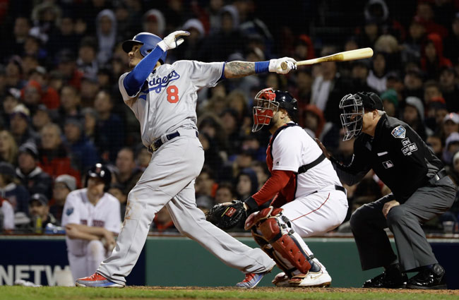 <div class='meta'><div class='origin-logo' data-origin='AP'></div><span class='caption-text' data-credit='AP Photo/Matt Slocum'>Los Angeles Dodgers' Manny Machado hits an RBI sacrifice fly during Game 1 of the World Series baseball game against the Boston Red Sox Tuesday, Oct. 23, 2018.</span></div>
