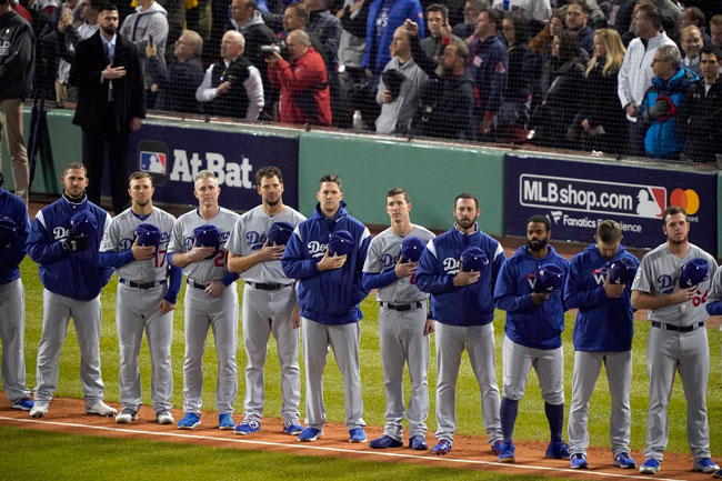 <div class='meta'><div class='origin-logo' data-origin='AP'></div><span class='caption-text' data-credit='AP Photo/Elise Amendola'>Los Angeles Dodgers players during the national anthem before Game 1 of the World Series baseball game against the Boston Red Sox Tuesday, Oct. 23, 2018.</span></div>