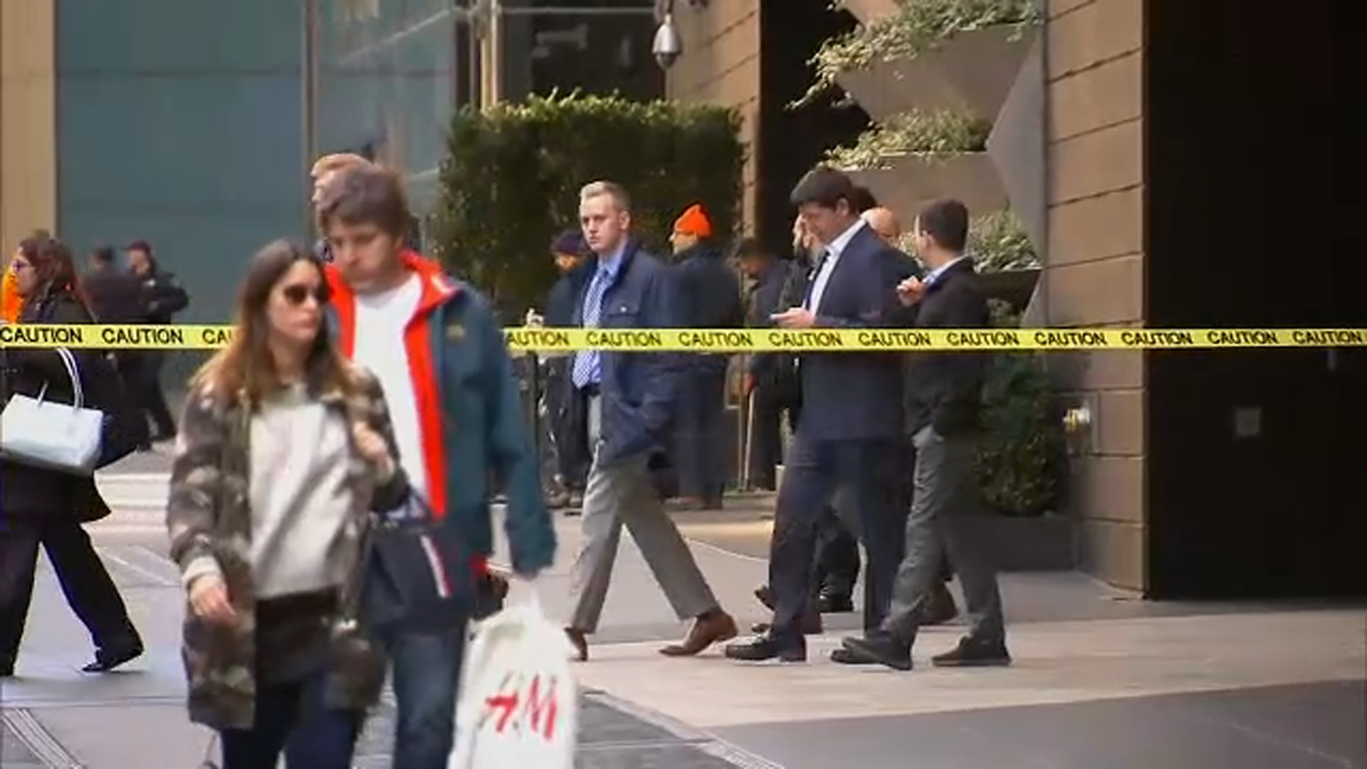 "<div class=""meta image-caption""><div class=""origin-logo origin-image none""><span>none</span></div><span class=""caption-text"">Authorities and pedestrians are shown on the scene of a suspicious package near the CNN building in New York.</span></div>"