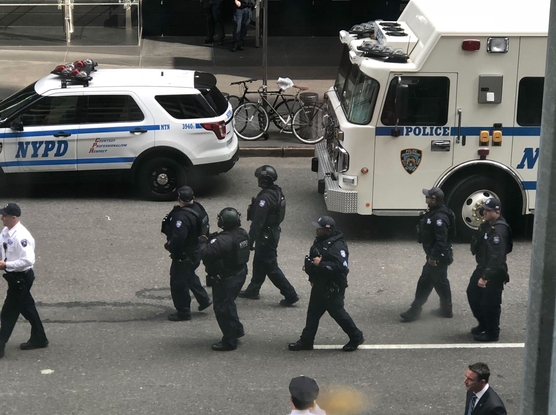 <div class='meta'><div class='origin-logo' data-origin='none'></div><span class='caption-text' data-credit='Mark Wilson/Twitter'>Authorities are shown on the scene near the Time Warner Center, where the CNN offices are located in New York.</span></div>