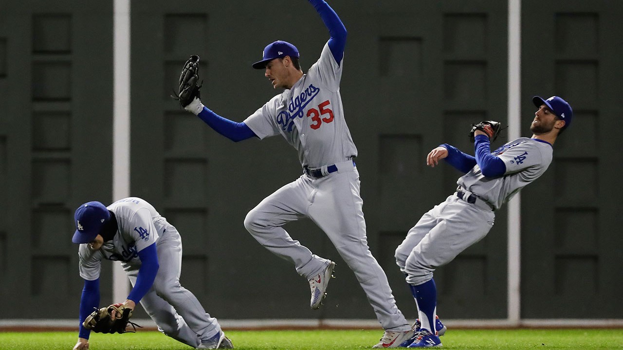 <div class='meta'><div class='origin-logo' data-origin='AP'></div><span class='caption-text' data-credit='AP Photo/David J. Phillip'>Dodger Cody Bellinger catches a fly ball from Boston's Ian Kinsler in between Enrique Hernandez and Chris Taylor during Game 2 of the World Series at Fenway Park.</span></div>