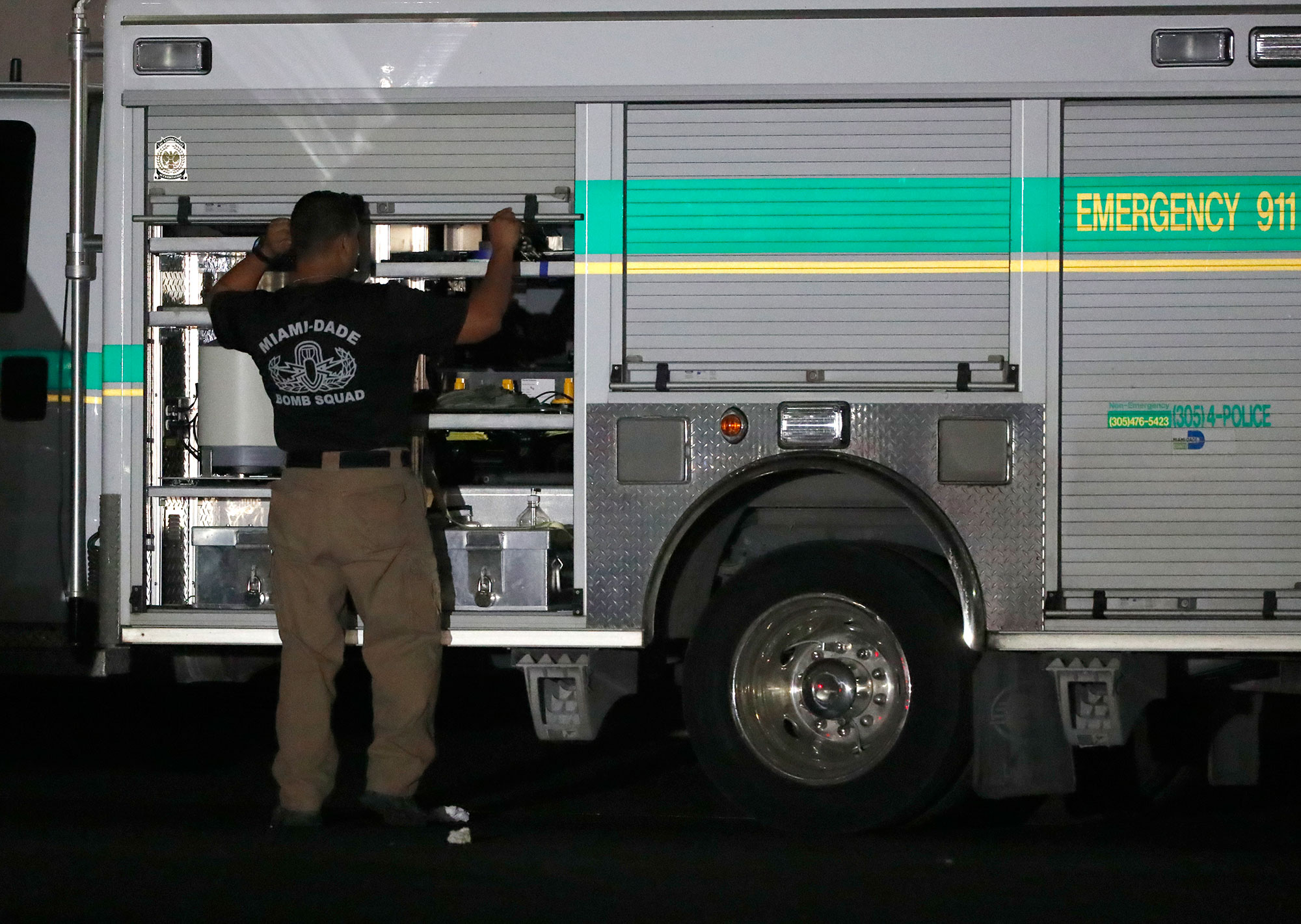 <div class='meta'><div class='origin-logo' data-origin='none'></div><span class='caption-text' data-credit='Wilfredo Lee/AP Photo'>A member of the Miami-Dade County Bomb Squad is shown outside a postal facility, Thursday, Oct. 25, 2018, in Opa-Locka, Fla.</span></div>
