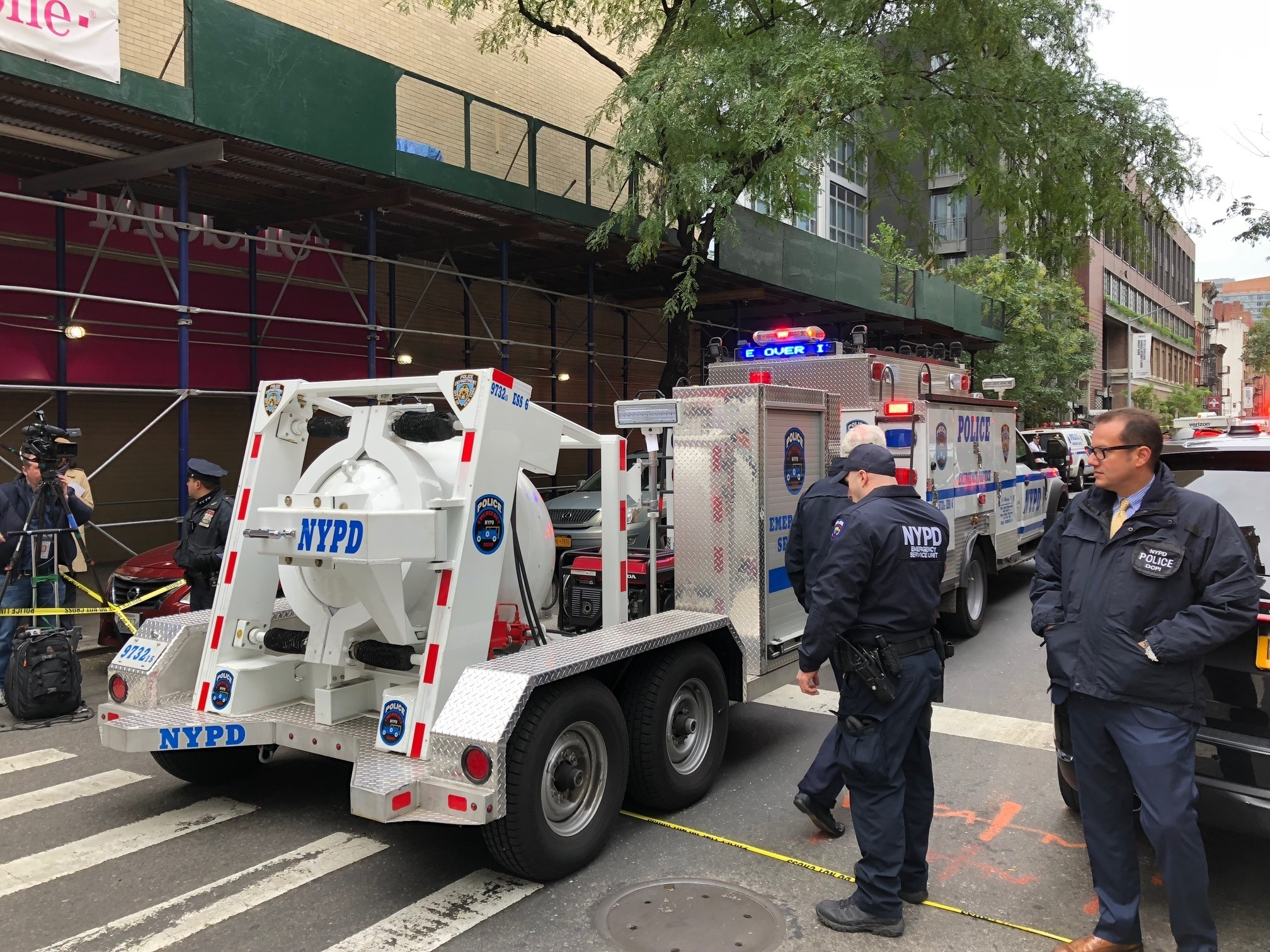<div class='meta'><div class='origin-logo' data-origin='none'></div><span class='caption-text' data-credit='Mark Lennihan/AP Photo'>NYPD's Total Containment vessel arrives as law enforcement respond to the scene of a suspicious package at a postal facility, Friday, Oct. 26, 2018 in New York.</span></div>