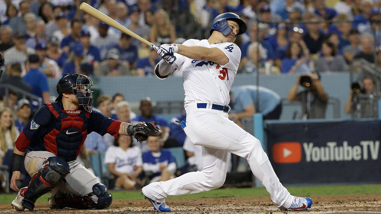 <div class='meta'><div class='origin-logo' data-origin='AP'></div><span class='caption-text' data-credit='AP Photo/David J. Phillip'>Los Angeles Dodgers' Joc Pederson follows through on his home run during the third inning in Game 3 of the World Series.</span></div>