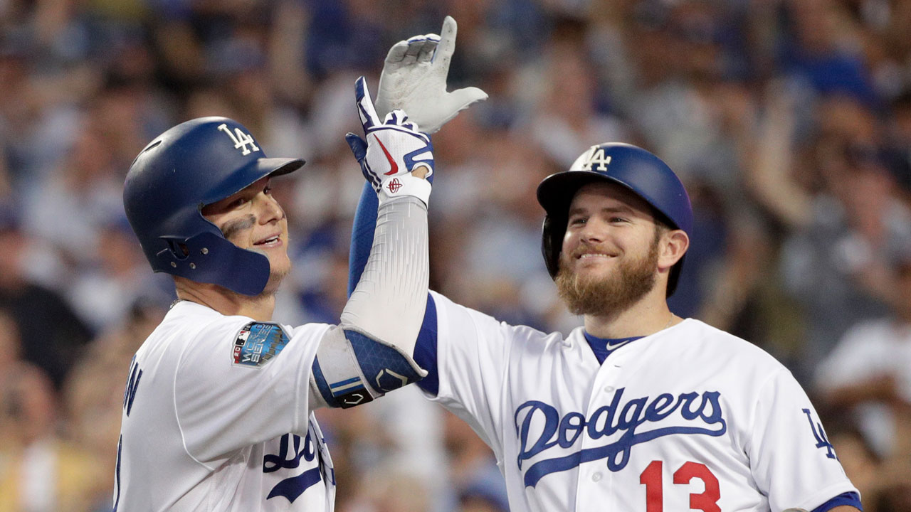 <div class='meta'><div class='origin-logo' data-origin='AP'></div><span class='caption-text' data-credit='AP Photo/Jae C. Hong'>Los Angeles Dodgers' Joc Pederson celebrates with Max Muncy after a home run against the Boston Red Sox during Game 3 of the World Series baseball game in Los Angeles.</span></div>