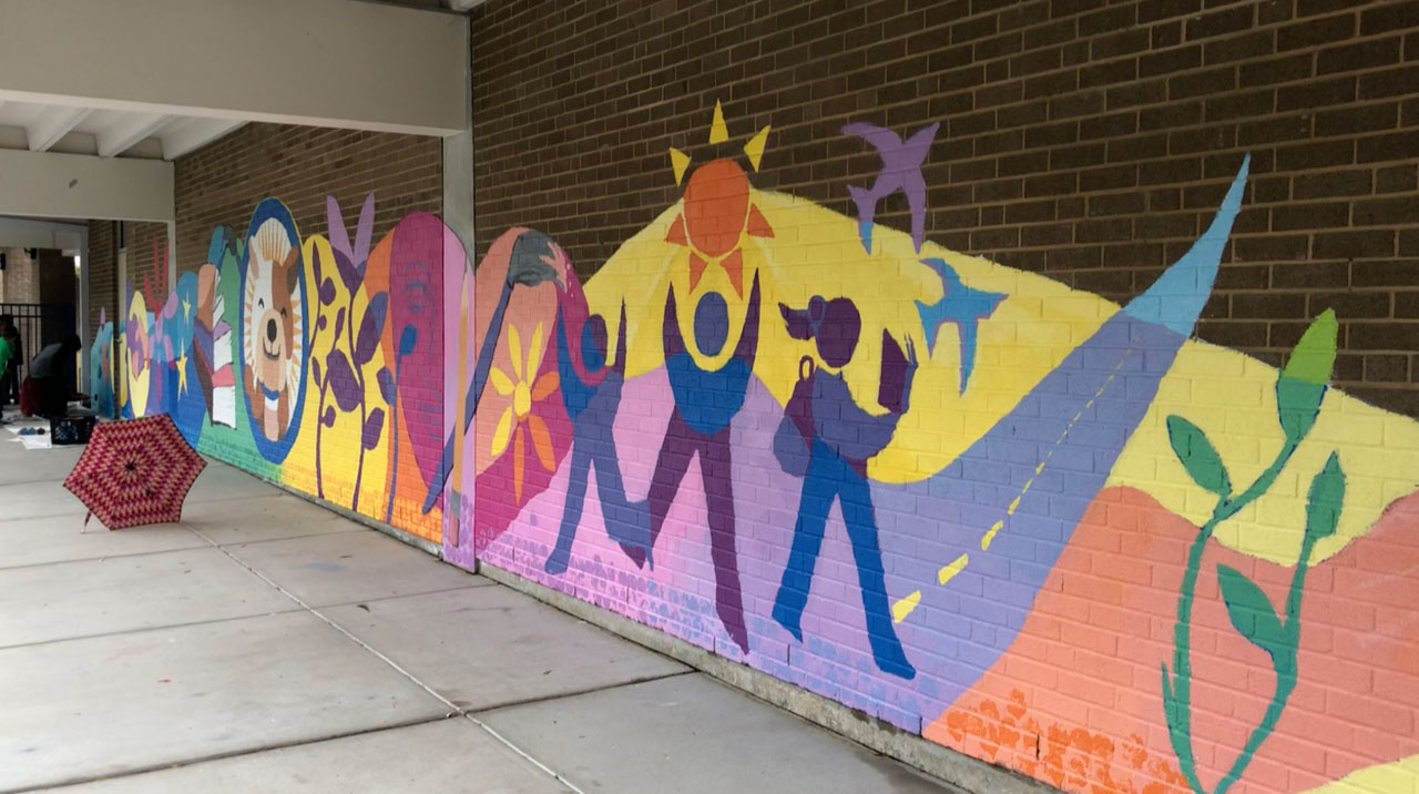 "<div class=""meta image-caption""><div class=""origin-logo origin-image wtvd""><span>WTVD</span></div><span class=""caption-text"">The project was inspired by this year's Read for the Record campaign selection, Maybe Something Beautiful: How Art Transformed a Neighborhood by F. Isabel Campoy. (Tisha Powell)</span></div>"