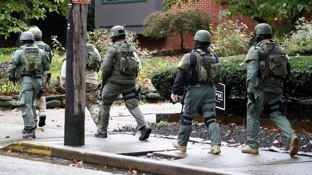 <div class='meta'><div class='origin-logo' data-origin='AP'></div><span class='caption-text' data-credit='AP Photo/Gene J. Puskar'>A SWAT team arrives at the Tree of Life Synagogue in Pittsburgh, Pa. where a shooter opened fire injuring multiple people, Saturday, Oct. 27, 2018.</span></div>