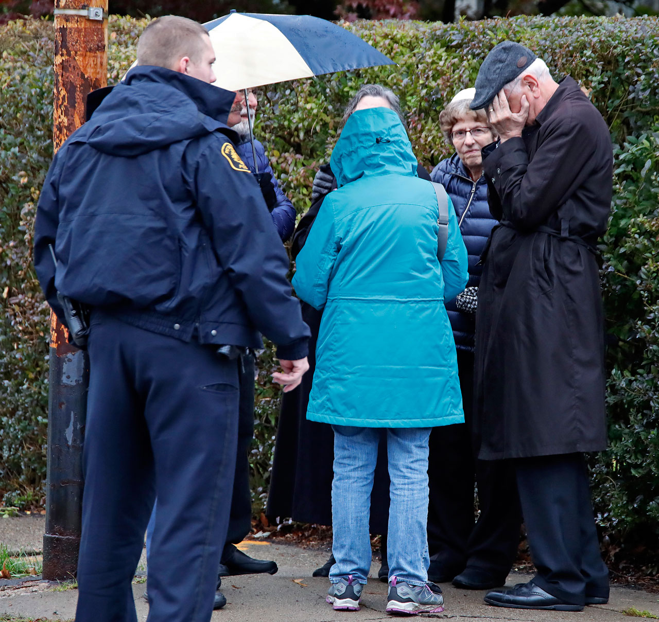 <div class='meta'><div class='origin-logo' data-origin='AP'></div><span class='caption-text' data-credit='AP Photo/Gene J. Puskar'>People gather on a corner near the Tree of Life Synagogue in Pittsburgh, Pa., where a shooter opened fire Saturday, Oct. 27, 2018, injuring multiple people.</span></div>