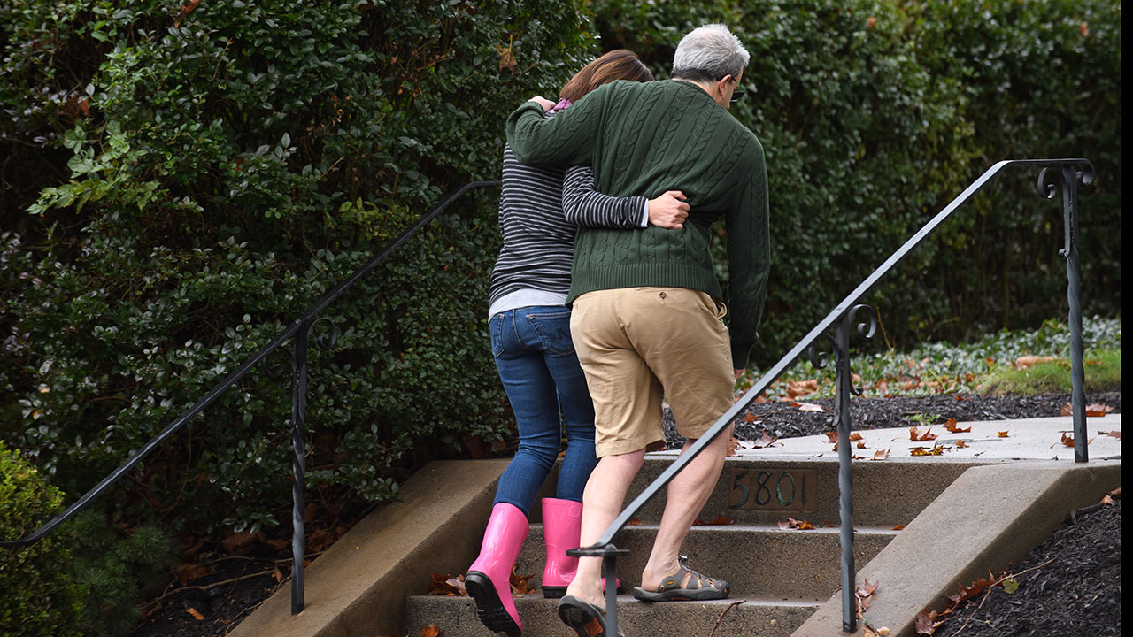 "<div class=""meta image-caption""><div class=""origin-logo origin-image wpvi""><span>wpvi</span></div><span class=""caption-text"">Neighbors around the corner from the site of a mass shooting at the Tree of Life Synagogue embrace one another in the Squirrel Hill neighborhood. (Jeff Swensen/Getty Images)</span></div>"