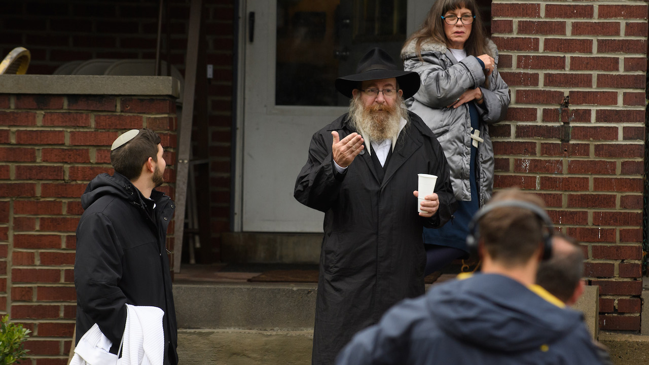"<div class=""meta image-caption""><div class=""origin-logo origin-image wpvi""><span>wpvi</span></div><span class=""caption-text"">Residents talk to the media near the site of a shooting at the Tree of Life Synagogue in the Squirrel Hill neighborhood on October 27, 2018, in Pittsburgh, Pennsylvania. (Jeff Swensen/Getty Images)</span></div>"