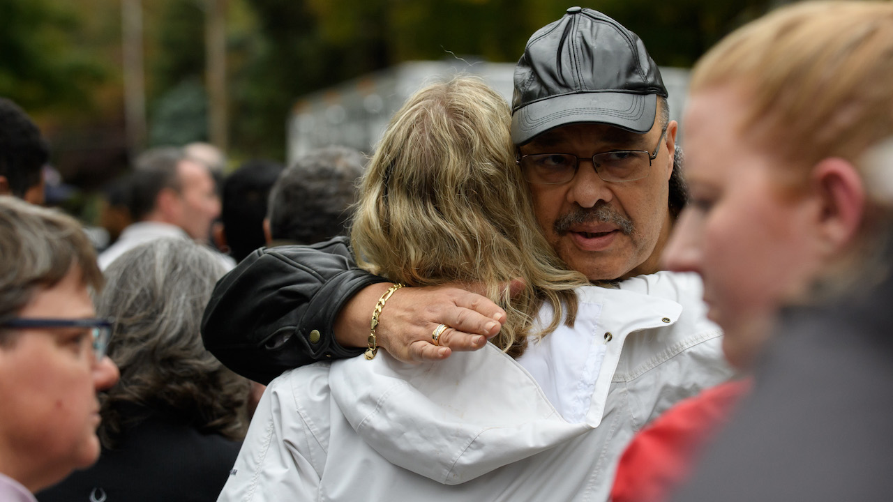 "<div class=""meta image-caption""><div class=""origin-logo origin-image wpvi""><span>wpvi</span></div><span class=""caption-text"">People comfort each other at the site of a mass shooting at the Tree of Life Synagogue in the Squirrel Hill neighborhood on October 27, 2018, in Pittsburgh. (Jeff Swensen/Getty Images)</span></div>"
