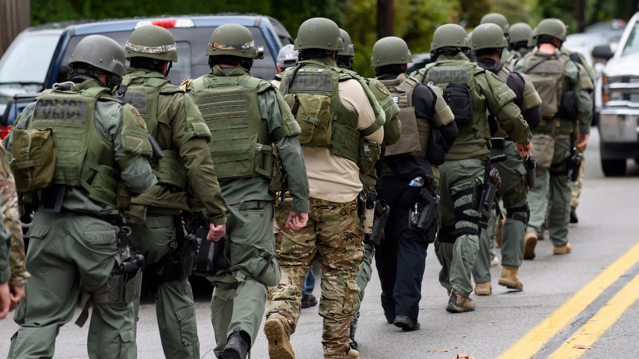 <div class='meta'><div class='origin-logo' data-origin='Creative Content'></div><span class='caption-text' data-credit='Jeff Swensen/Getty Images'>Rapid reaction SWAT members leave the scene of a mass shooting at the Tree of Life Synagogue in the Squirrel Hill neighborhood on October 27, 2018, in Pittsburgh, Pennsylvania.</span></div>