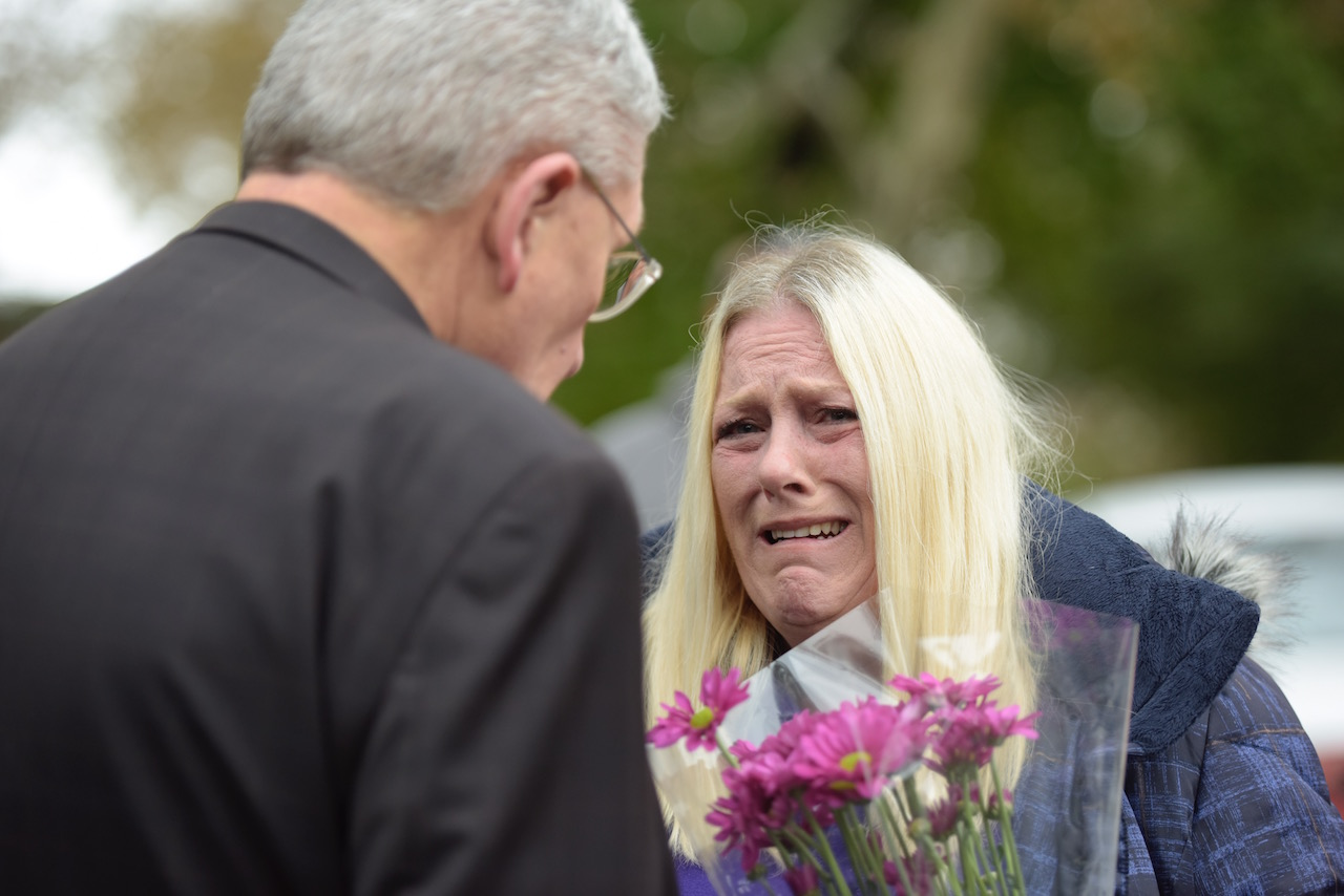 <div class='meta'><div class='origin-logo' data-origin='Creative Content'></div><span class='caption-text' data-credit='Eric Baradat/AFP/Getty Images'>Denise Fulton cries as she speaks with Bishop David Zubick after she came to show support for members of the community near the Tree of Life Synagogue.</span></div>