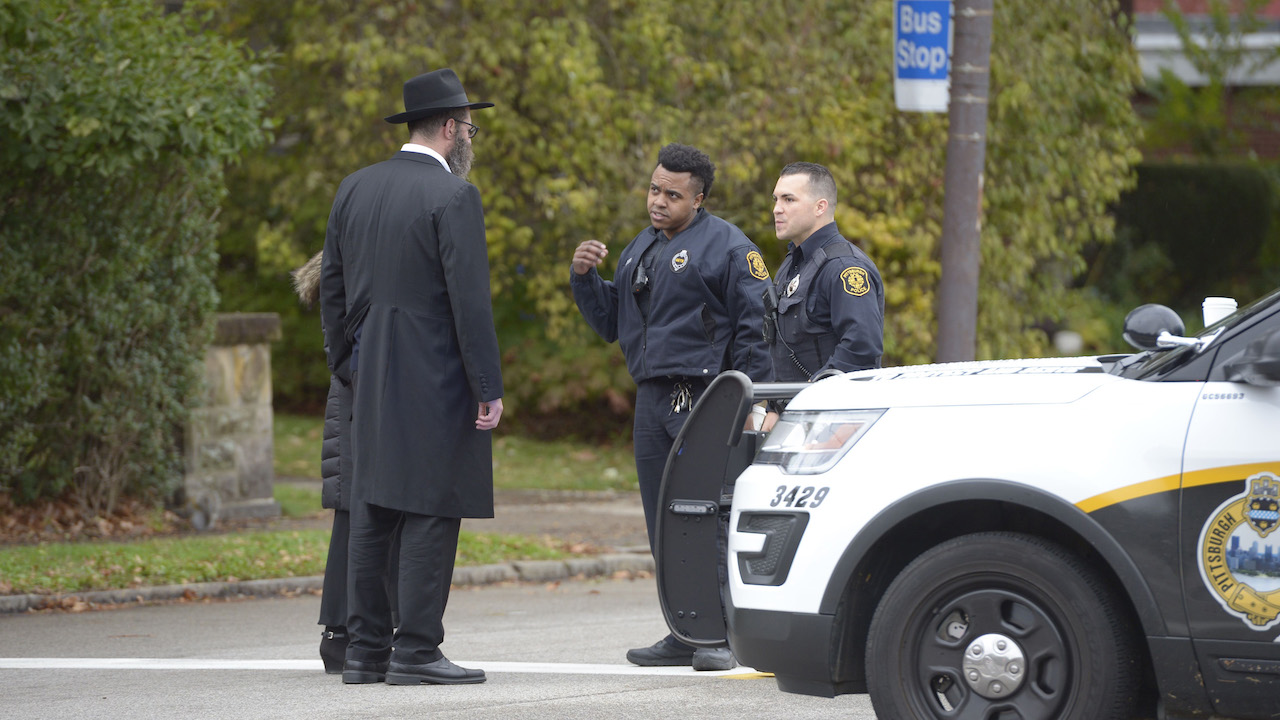"<div class=""meta image-caption""><div class=""origin-logo origin-image wpvi""><span>wpvi</span></div><span class=""caption-text"">Police speak with members of the community after a shooting at the Tree of Life Synagogue at Squirrel Hill, Pennsylvania on October 27, 2018. (Dustin Franz/AFP/Getty Images)</span></div>"
