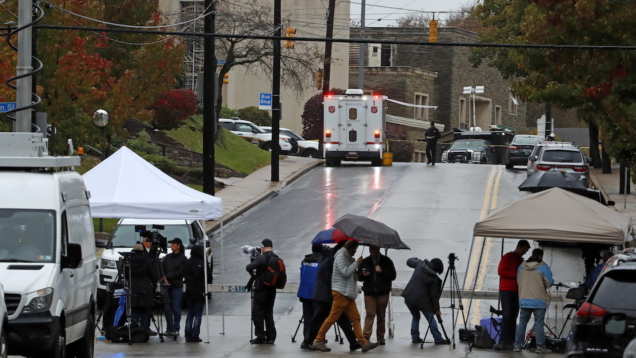 <div class='meta'><div class='origin-logo' data-origin='AP'></div><span class='caption-text' data-credit='AP Photo/Gene J. Puskar'>Media tents and vehicles line an intersection near the Tree of Life Synagogue, upper left, where a shooter opened fire Saturday, Oct. 27, 2018.</span></div>