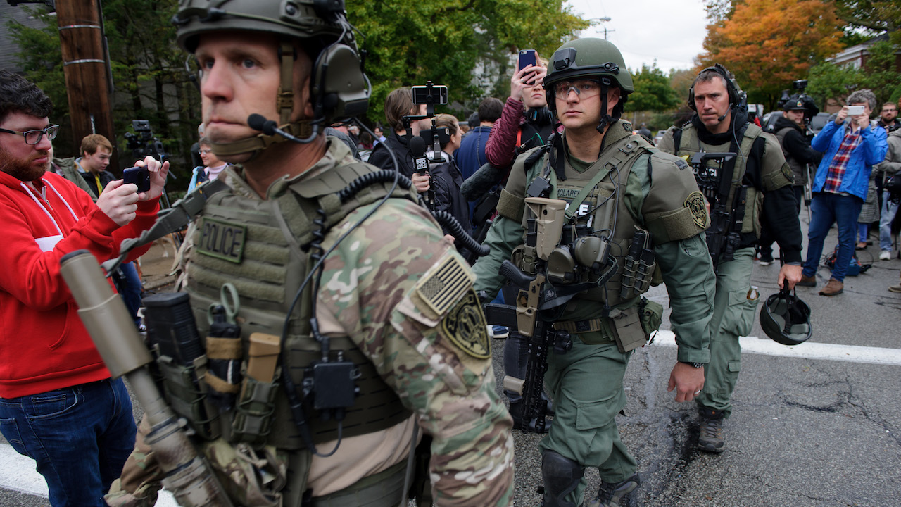 <div class='meta'><div class='origin-logo' data-origin='AP'></div><span class='caption-text' data-credit='Jeff Swensen/Getty Images'>Rapid reaction SWAT members leave the scene of a mass shooting at the Tree of Life Synagogue in the Squirrel Hill neighborhood on October 27, 2018, in Pittsburgh, Pennsylvania.</span></div>