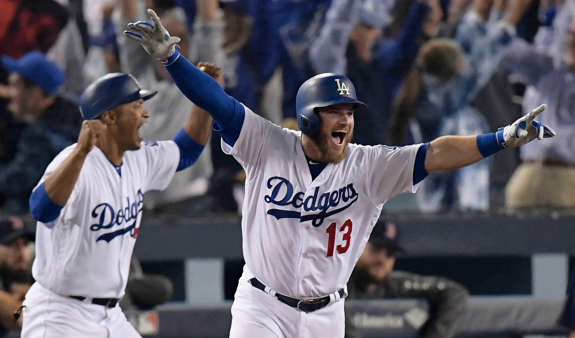 <div class='meta'><div class='origin-logo' data-origin='AP'></div><span class='caption-text' data-credit='AP Photo/Mark J. Terrill'>Los Angeles Dodgers' Max Muncy celebrates his walk off home run against the Boston Red Sox during the 18th inning in Game 3 of the World Series.</span></div>
