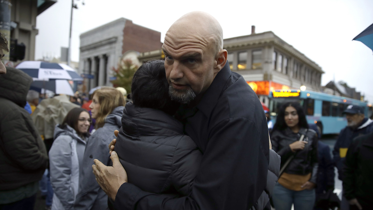 <div class='meta'><div class='origin-logo' data-origin='AP'></div><span class='caption-text' data-credit='AP Photo/Matt Rourke'>Braddock, Pa., Mayor John Fetterman hugs a person as they gather for a vigil in the aftermath of a deadly shooting at the Tree of Life Congregation.</span></div>