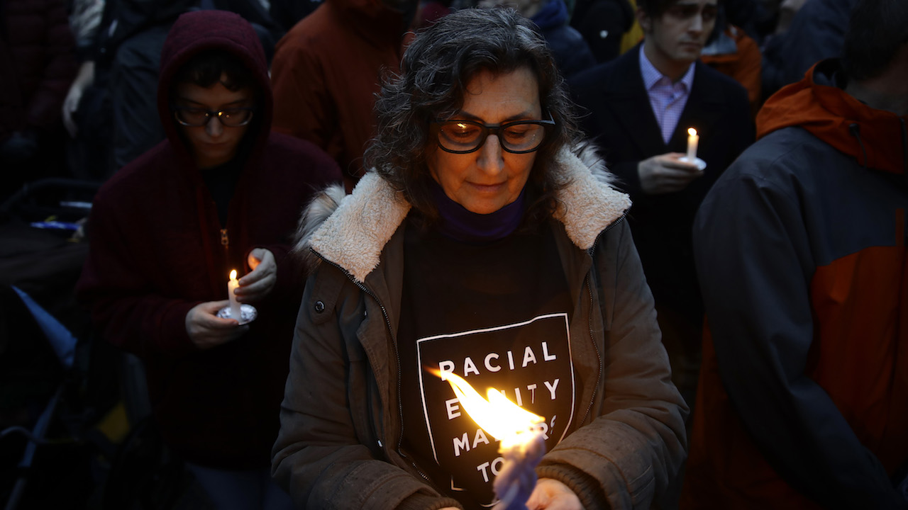 "<div class=""meta image-caption""><div class=""origin-logo origin-image ap""><span>AP</span></div><span class=""caption-text"">People hold candles as they gather for a vigil in the aftermath of a deadly shooting at the Tree of Life Synagogue, in the Squirrel Hill neighborhood of Pittsburgh. (AP Photo/Matt Rourke)</span></div>"
