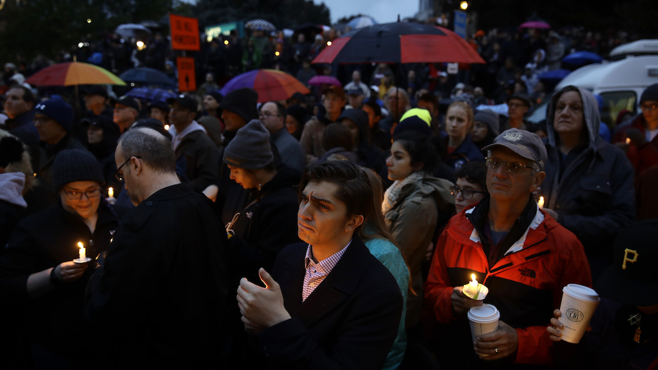 <div class='meta'><div class='origin-logo' data-origin='AP'></div><span class='caption-text' data-credit='AP Photo/Matt Rourke'>People hold candles as they gather for a vigil in the aftermath of a deadly shooting at the Tree of Life Synagogue.</span></div>
