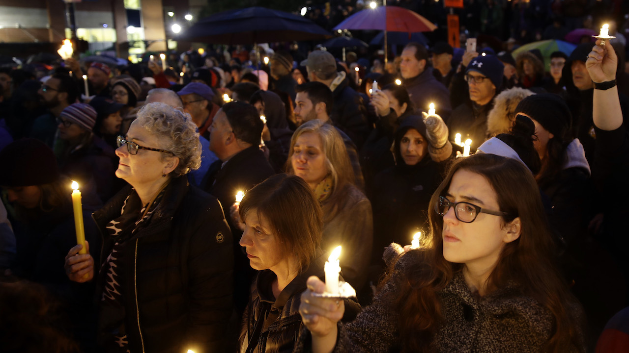 <div class='meta'><div class='origin-logo' data-origin='AP'></div><span class='caption-text' data-credit='AP Photo/Matt Rourke'>People hold candles as they gather for a vigil in the aftermath of a deadly shooting at the Tree of Life Congregation, in the Squirrel Hill neighborhood of Pittsburgh.</span></div>