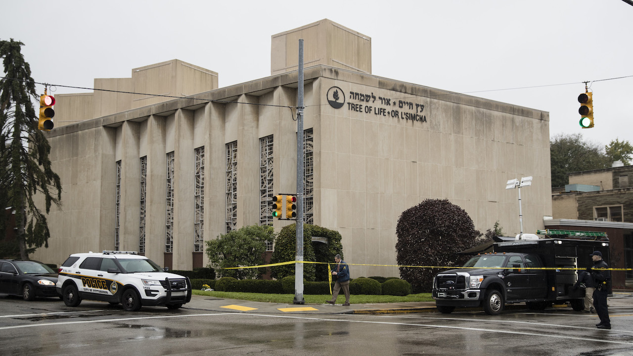 <div class='meta'><div class='origin-logo' data-origin='AP'></div><span class='caption-text' data-credit='AP Photo/Matt Rourke'>Police stand guard outside the Tree of Life Synagogue in Pittsburgh where a shooter opened fire Saturday, Oct. 27, 2018.</span></div>