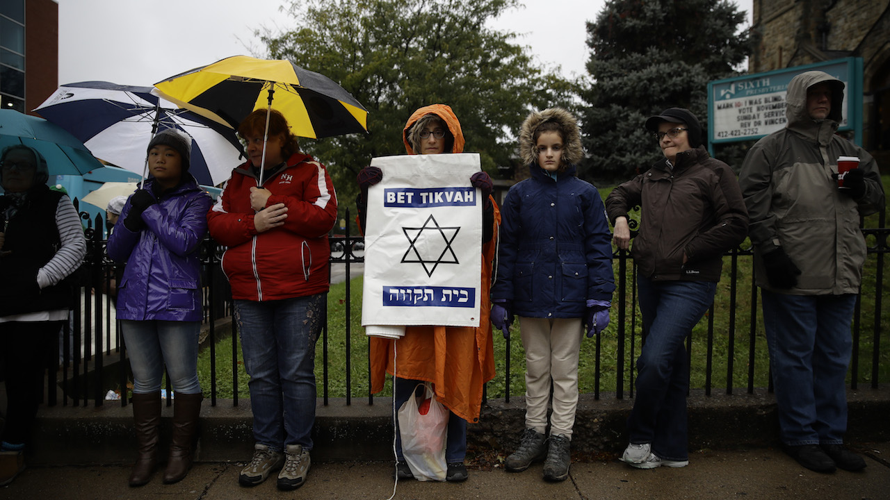 <div class='meta'><div class='origin-logo' data-origin='AP'></div><span class='caption-text' data-credit='AP Photo/Matt Rourke'>Deb Polk holds a sign as she gathers with others for a vigil in the aftermath of a deadly shooting at the Tree of Life Synagogue in Pittsburgh, Saturday, Oct. 27, 2018.</span></div>