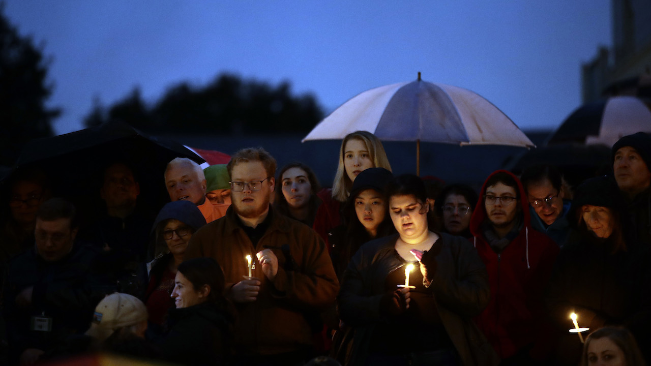 "<div class=""meta image-caption""><div class=""origin-logo origin-image ap""><span>AP</span></div><span class=""caption-text"">People hold candles as they gather for a vigil in the aftermath of a deadly shooting at the Tree of Life Congregation, in the Squirrel Hill neighborhood of Pittsburgh. (AP Photo/Matt Rourke)</span></div>"