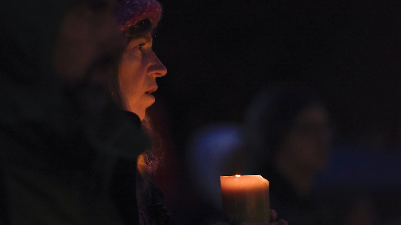 "<div class=""meta image-caption""><div class=""origin-logo origin-image ap""><span>AP</span></div><span class=""caption-text"">A woman holds a candle during a vigil in Squirrel Hill, Pennsylvania on October 27, 2018, to remember those that died in the Tree of Life Synagogue shooting earlier in the day. (Dustin Franz/AFP/Getty Images)</span></div>"