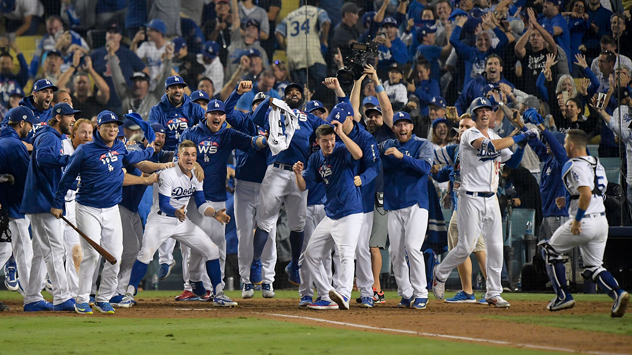 <div class='meta'><div class='origin-logo' data-origin='AP'></div><span class='caption-text' data-credit='AP Photo/Mark J. Terrill'>The Los Angeles Dodgers celebrates after Max Muncy's walk off home run during the 18th inning in Game 3 of the World Series</span></div>