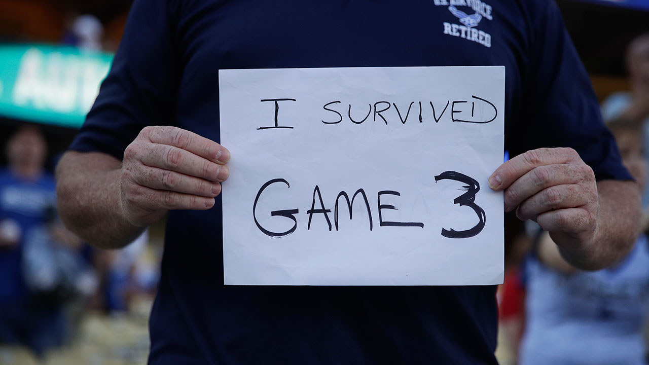 <div class='meta'><div class='origin-logo' data-origin='AP'></div><span class='caption-text' data-credit='AP Photo/Jae C. Hong'>A fan holds up a sign referring to World Series Game 3.</span></div>