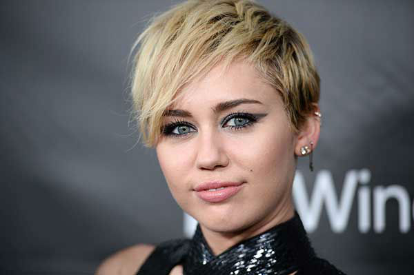"<div class=""meta image-caption""><div class=""origin-logo origin-image ""><span></span></div><span class=""caption-text"">4. Miley Cyrus (Photo/Jordan Strauss)</span></div>"