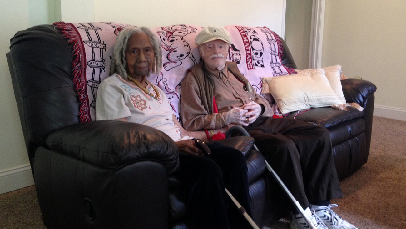 In this Aug. 5, 2014 file photo, 96-year-old Edith Hill and 95-year-old Eddie Harrison are seen in their home in Annandale, Va.