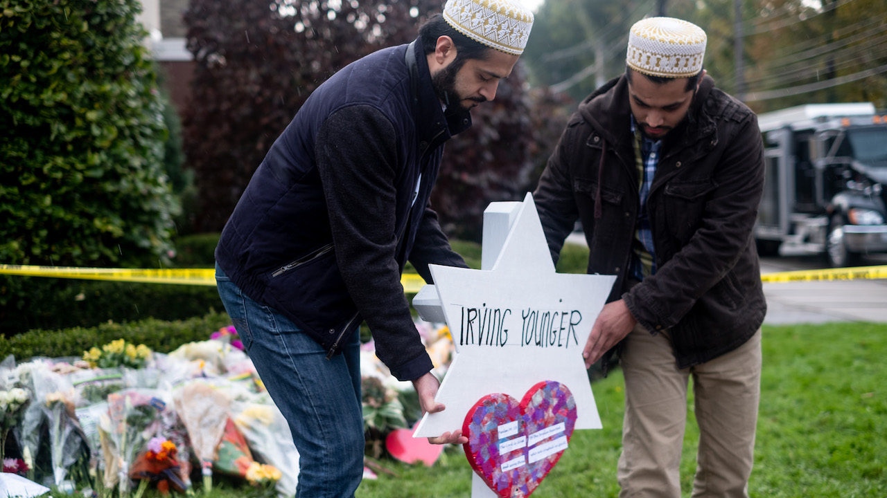 <div class='meta'><div class='origin-logo' data-origin='AP'></div><span class='caption-text' data-credit='Aaron Jackendoff/SOPA Images/LightRocket via Getty Images'>Muslims from Hydrabad seen placing a temporary grave for Irving Younger at the makeshift memorial after the tragic shooting in Pittsburgh at the Tree of Life.</span></div>