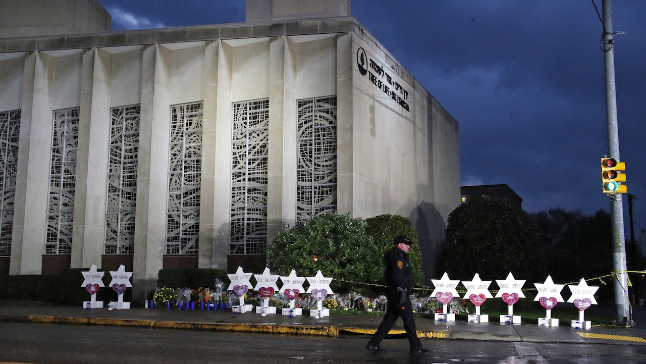 "<div class=""meta image-caption""><div class=""origin-logo origin-image ap""><span>AP</span></div><span class=""caption-text"">A Pittsburgh Police officer walks past the Tree of Life Synagogue and a memorial of flowers and stars in Pittsburgh on Sunday, Oct. 28, 2018. (AP Photo/Gene J. Puskar)</span></div>"