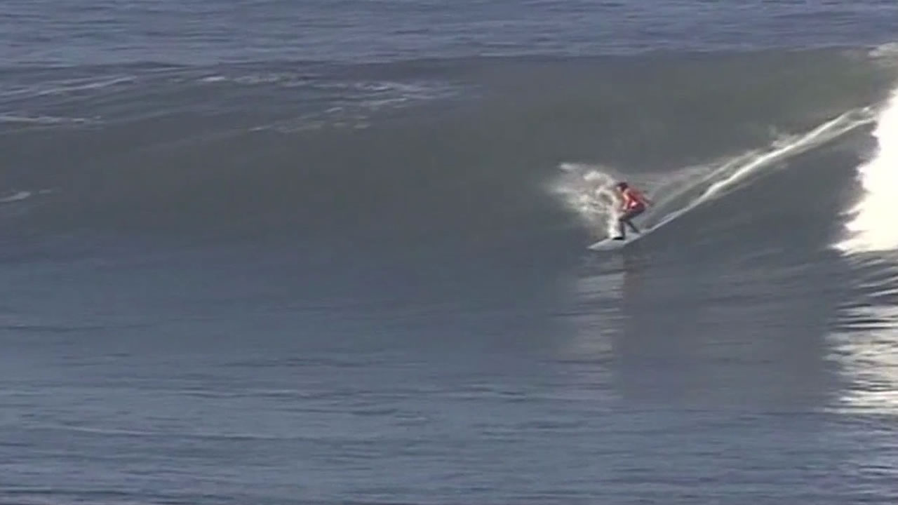 surfer riding a wave at Mavericks Surf Contest