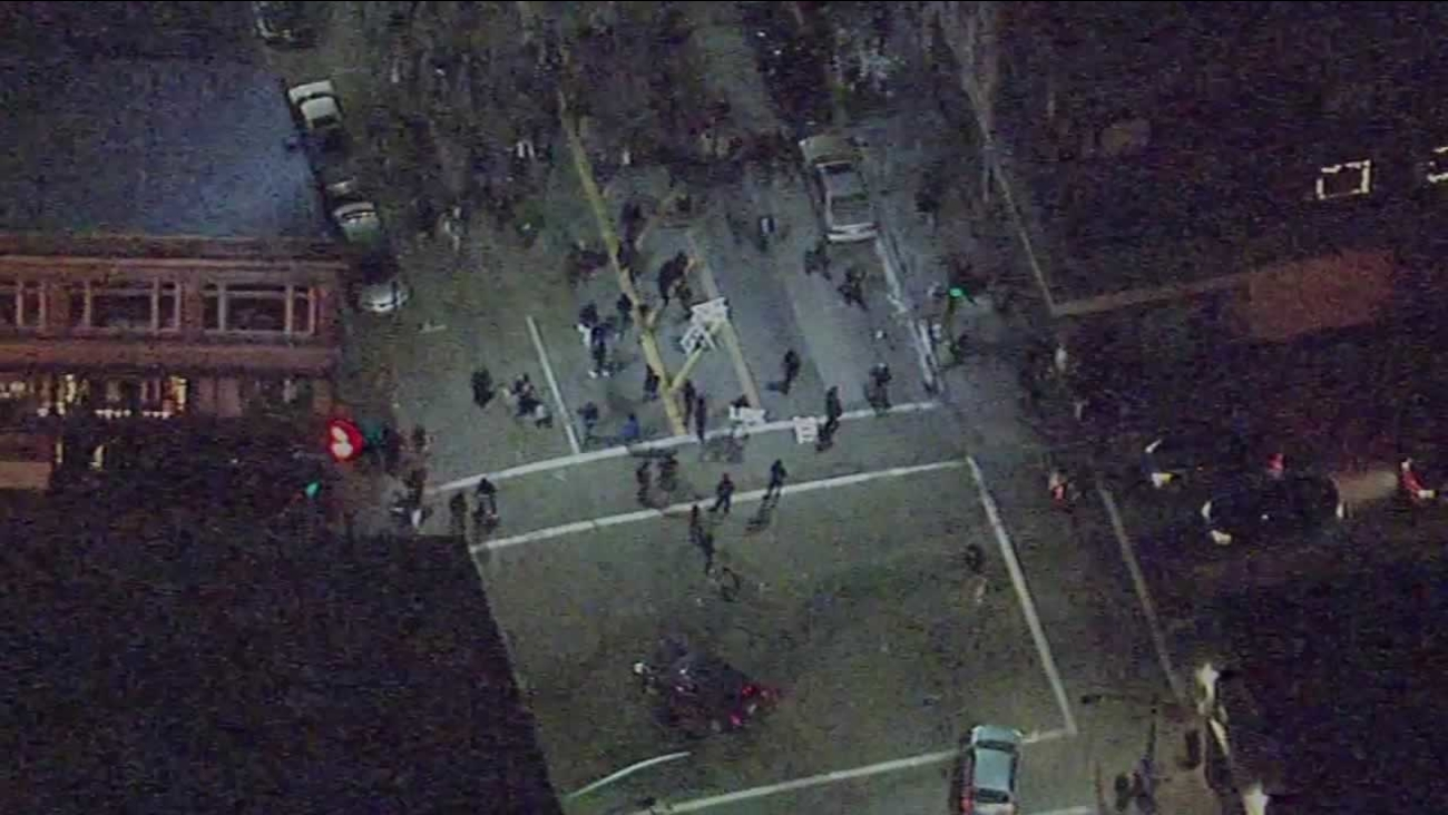 Sky7 HD was over the crowd protesting against police brutality at 14th and Broadway in Oakland on New Year's Eve .