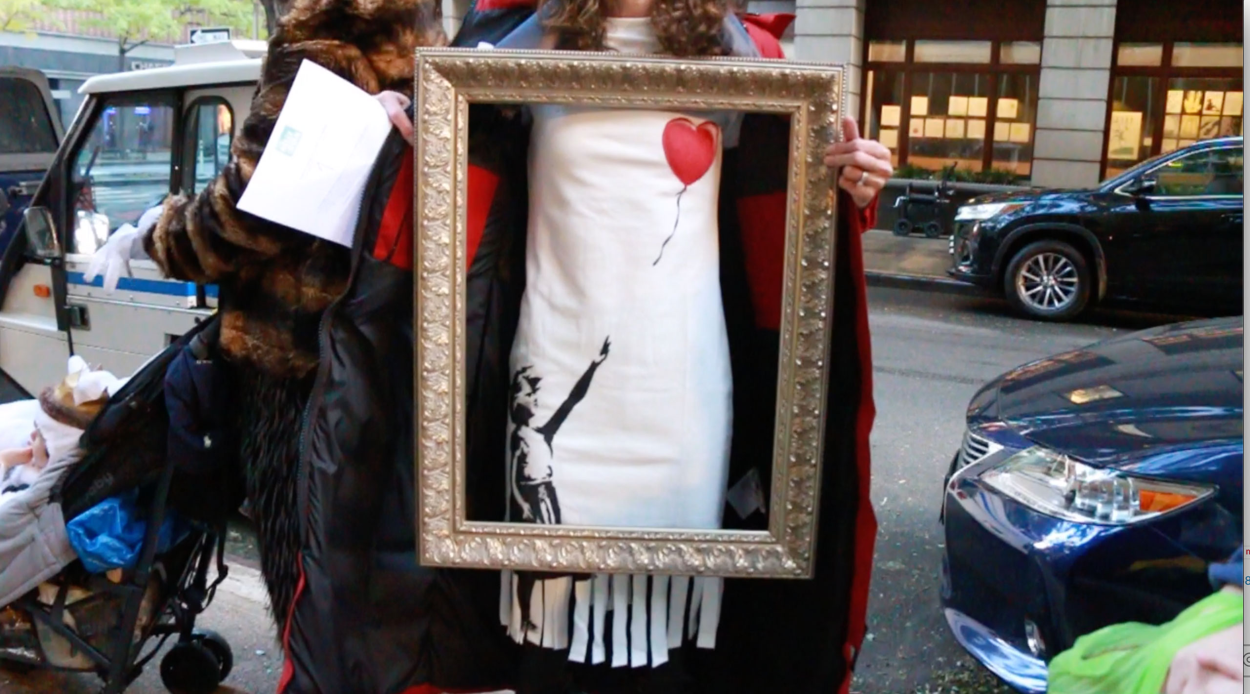 <div class='meta'><div class='origin-logo' data-origin='none'></div><span class='caption-text' data-credit=''>One woman showed up dressed as the doomed artwork by Banksy that was shredded at an auction earlier this year.</span></div>