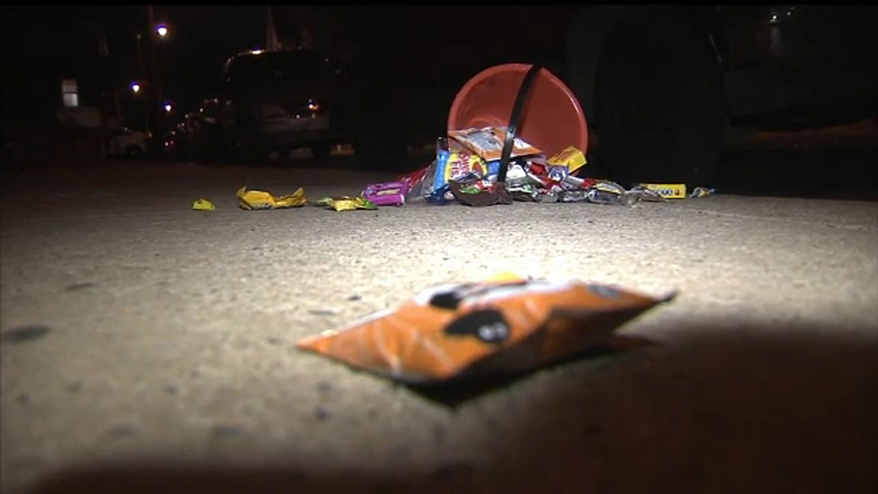 b69660e450e1a A container of candy dropped on the sidewalk could be seen inches away from  shell casings.