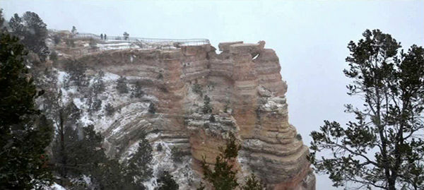 """<div class=""""meta image-caption""""><div class=""""origin-logo origin-image """"><span></span></div><span class=""""caption-text"""">Few tourists walk out to Mather Point at Grand Canyon in Arizona on New Year's Eve. (Grand Canyon National Parks Service)</span></div>"""