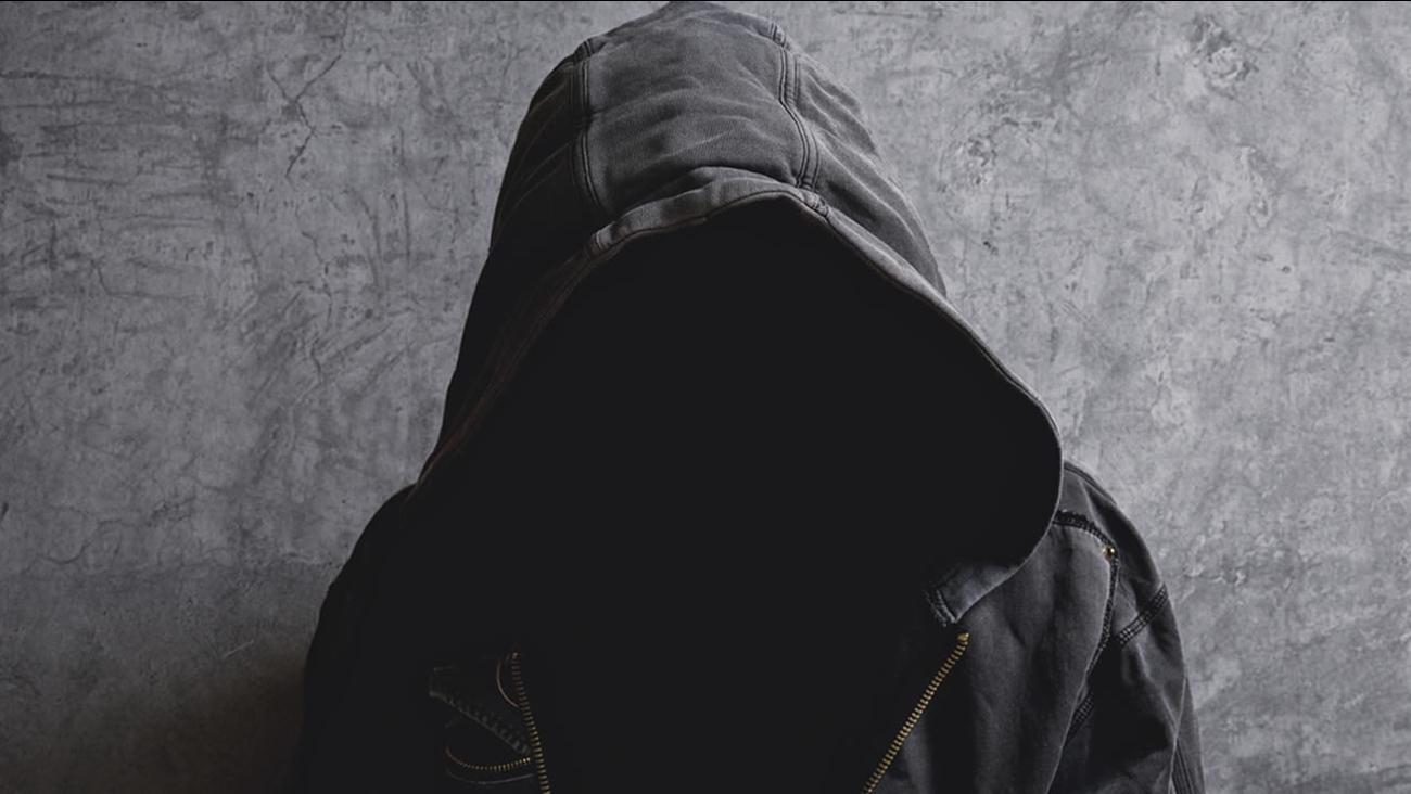 Person wearing hoodie.